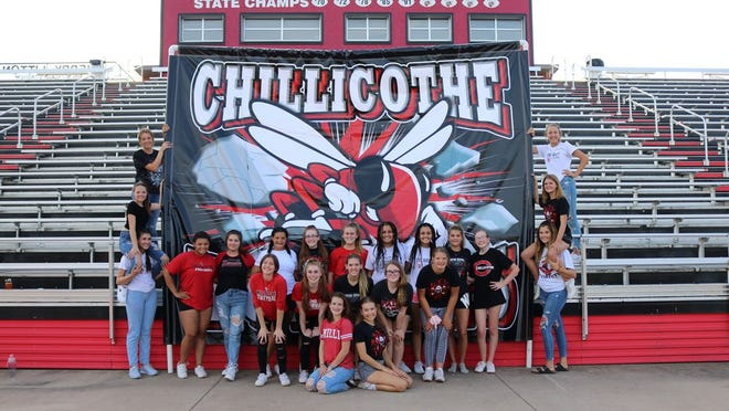Chillicothe Cheerleaders pose with the new run-through sign, purchased for home games.  Area residents, families, and organizations raised the $1400 needed for the sign. The sign was one item Coach Jessica Saucedo wanted for use at home games.