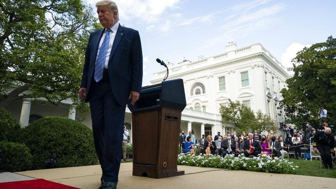 President Donald Trump leaves after an event about coronavirus testing strategy, in the Rose Garden of the White House, Monday, Sept. 28, 2020, in Washington.