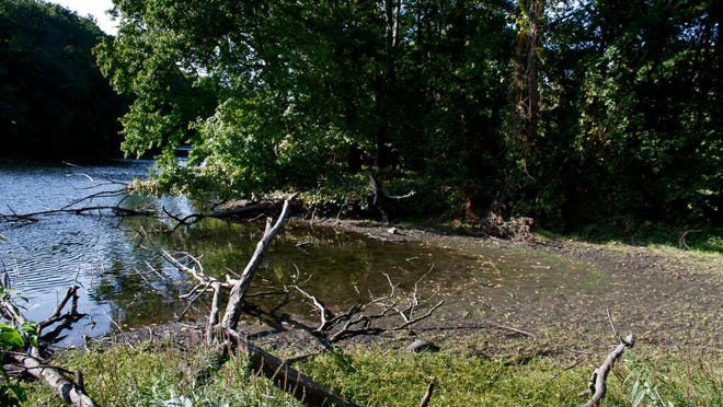 Low water levels expose the banks of the Blackstone River near the Albion Dam last week.