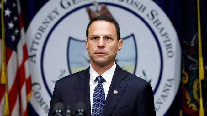 FILE - In this Aug. 14, 2018, file photo, Pennsylvania Attorney General Josh Shapiro speaks about a grand jury's report on clergy abuse in the Roman Catholic Church during a news conference at the Capitol in Harrisburg, Pa. The U.S. Justice Department opened their own investigation and have served subpoenas on dioceses across the state, according to multiple sources who spoke to The Associated Press on condition of anonymity. The subpoenas follow the state grand jury report.