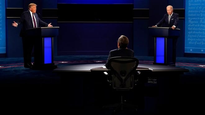 Moderator Chris Wallace of Fox News listens as President Donald Trump and Democratic candidate former Vice President Joe Biden participate in the first presidential debate Tuesday at Case Western University and Cleveland Clinic, in Cleveland, Ohio.
