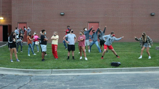 Rehearsals for the fall play have been staged outside for safety and in preparation for the football field performance.