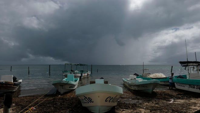 Boats sit closer to the shore after they were secured by fishermen preparing for the arrival of Hurricane Delta in Puerto Juarez, Cancun, Mexico, Tuesday, Oct. 6, 2020. Hurricane Delta rapidly intensified into a potentially catastrophic Category 4 hurricane Tuesday on a course to hammer southeastern Mexico and then continue on to the U.S. Gulf coast this week.