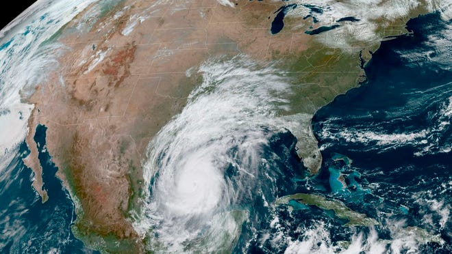 National Oceanic and Atmospheric Administration photo shows Hurricane Delta in the Gulf of Mexico on Thursday. Delta, gaining strength as it bears down on the U.S. Gulf Coast, is the latest and nastiest in a recent flurry of rapidly intensifying Atlantic hurricanes that scientists largely blame on global warming.