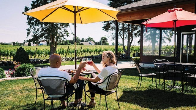 Newport Vineyards offers outdoor seating with a view of the vines.