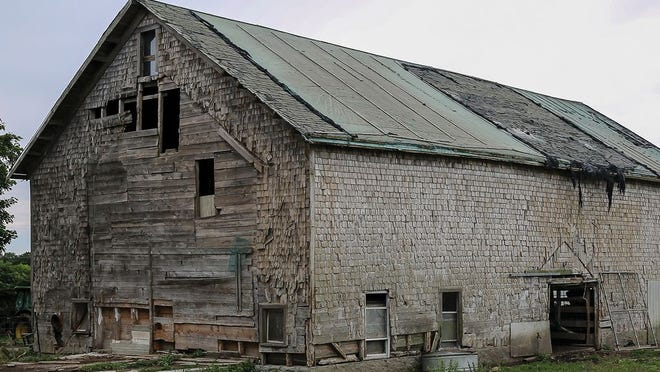 It would cost around $250,000 to fix the barn at Simmons Farm -- a sum the owners can ill afford. Meanwhile, decay and Mother Nature (right) are taking their toll.