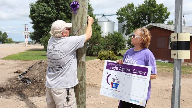 Members of Relay For Life have been busy Painting the Town Purple helping to keep the program in the eye of the public in recent days. Roger Pabst and Sherry Brandt placed purple bows and signs in a number of Redwood County communities, including Milroy, recently.