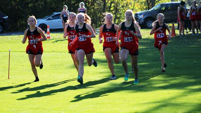 The Redwood Valley girls cross country team got a jump on the field at the start of the varsity race Thursday afternoon at the Redwood Falls Golf Club.