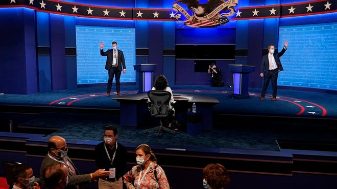 Mock debaters perform onstage as preparations take place for the second Presidential debate at Belmont University, Wednesday, Oct. 21, 2020, in Nashville, Tenn. President Donald Trump and Democratic presidential candidate, former Vice President Joe Biden are scheduled to debate Thursday, Oct. 22.