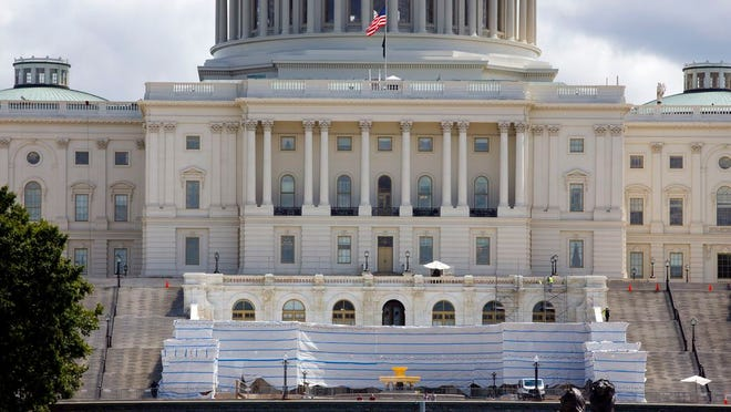 The West Front of the U.S. Capitol on Friday, Aug. 7, 2020, in Washington. While much of Washington is twisted in knots over the upcoming election, there's another contingent already busy trying to figure out how to stage an inauguration for the next president during a pandemic.