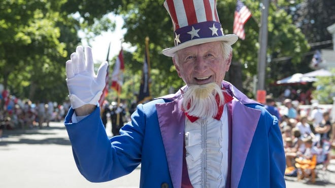 Uncle Sam greets spectators has he makes his way along the Hingham Fourth of July Parade route.