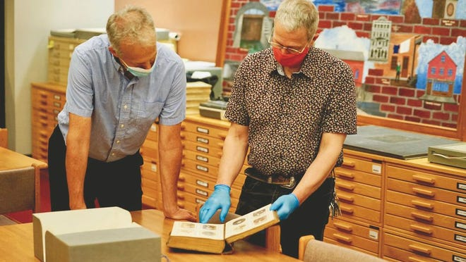 Gray Fitzsimons, a researcher in UMass Lowell's Department of World Languages and Cultures, left, and Anthony Sampas, archivist and special projects manager for the UMass Lowell Libraries, are key members of the team producing the Greater Boston Portuguese-American Digital Archive.
