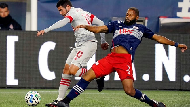 Toronto FC's Alejandro Pozuelo, left, and N.E. Revolution's Andrew Farrell pursue the ball during the second half of an MLS soccer match, Wednesday, Oct. 7, 2020, in Foxborough, Mass. Toronto FC won 1-0.