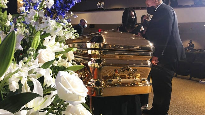 Martin Luther King III takes a moment by George Floyd's casket Thursday before a memorial service for George Floyd in Minneapolis.