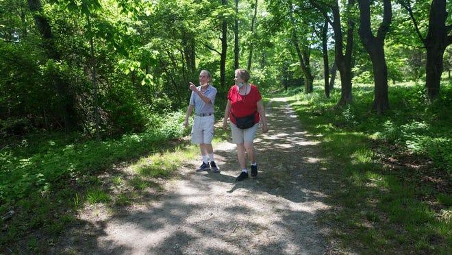 Wayne and Ellen Miller walk at World's End in Hingham.