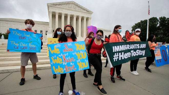 Deferred Action for Childhood Arrivals (DACA) students celebrate in front of the Supreme Court after the Supreme Court rejected President Donald Trump's effort to end legal protections for young immigrants, Thursday, June 18, 2020, in Washington.