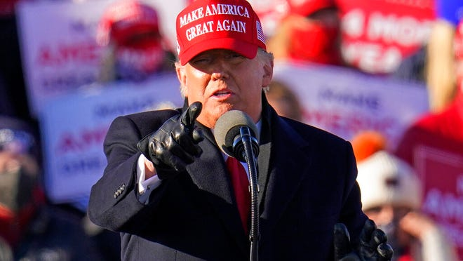 President Donald Trump gestures while addressing a campaign rally at the Wilkes-Barre Scranton International Airport in Avoca, Pa, Monday, Nov. 2, 2020.