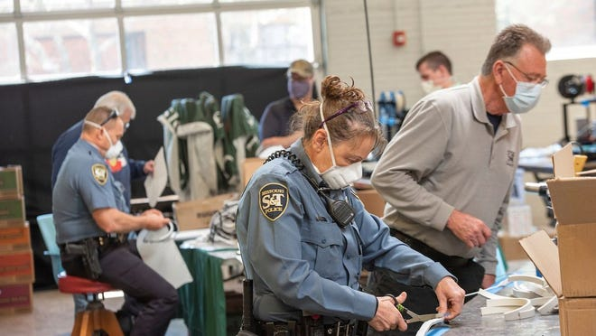 University Police and nurses from Phelps Health work to assemble face masks at the Student Design and Experiential Learning Center. Photo by Tom Wagner/Missouri S&T.
