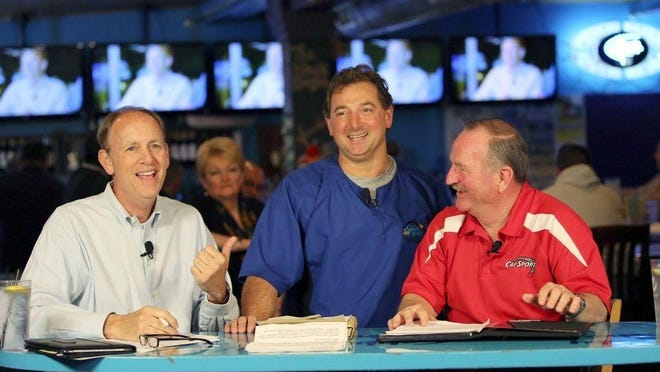 Cabby Brini, owner of The Cabbyshack, stands between former Boston sportscaster Mike Dowling  and Carl Pratt during the anniversary celebration of Pratt's Video Sports Page cable television show back in 2015.