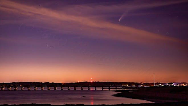 The comet Neowise appears in the sky over Duxbury's Powder Point Bridge.