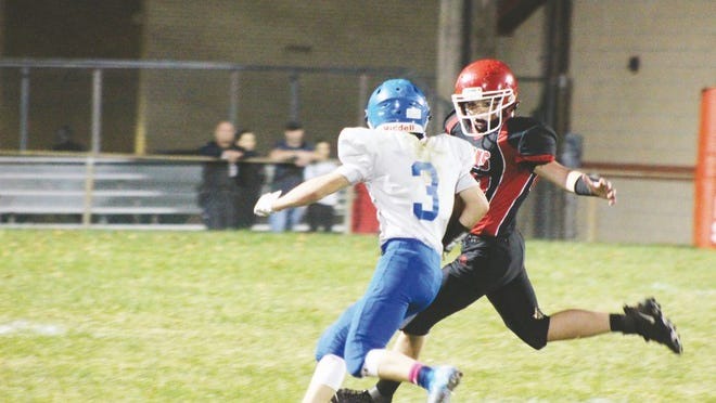Ripley's Ethan Kay, No. 3, runs the ball for the Vikings as Ravenswood's J.D. Thompson attempts the stop.