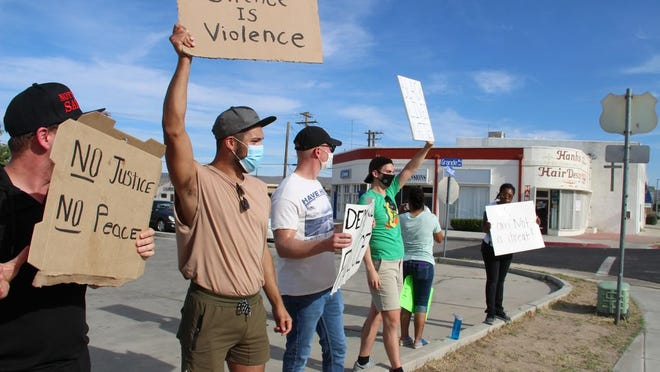 Demonstrators stage a peaceful protest over the death of Floyd George at the corner of China Lake Boulevard and Ridgecrest Boulevard Sunday. The majority of those taking part in the protest said they were Ridgecrest residents.