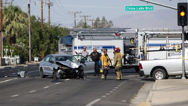 The Kern County Fire Department and Ridgecrest Police Department respond to a four-car accident outside of the Golden Ox on Tuesday morning.