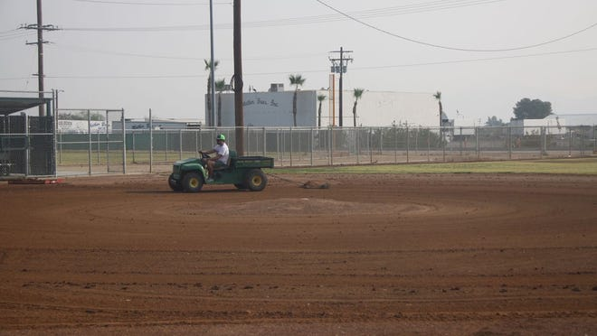 An adult volunteer drags the infield dirt during the Indian Wells Valley Youth Baseball League kicked off its fall ball season with a meeting and field maintenance.