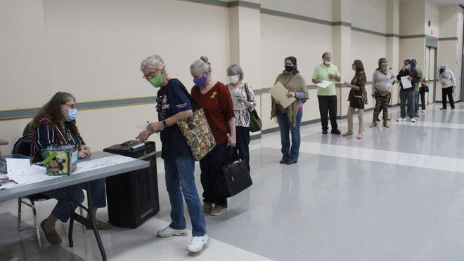 Voters wait in a long line to deposit their ballots on election day, Nov. 3, 202 at the Kerr McGee Center in Ridgecrest.