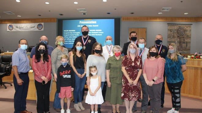 RPD Medal of Valour recipients pose with their families at the Ridgecrest City Council meeting Nov. 4, 2020.