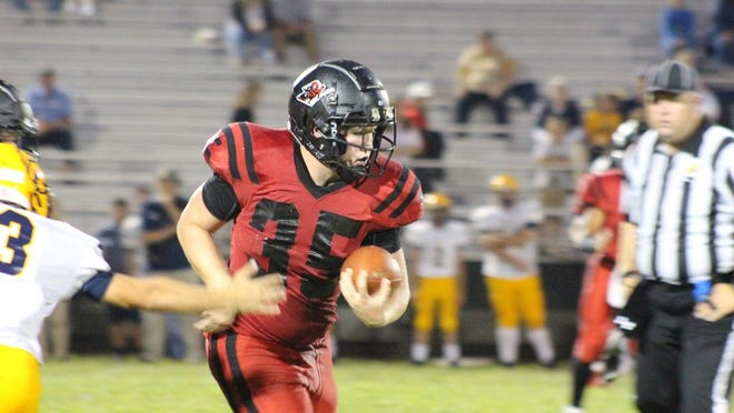 Jacob Anthony, No. 35, runs the ball for the Red Devils.