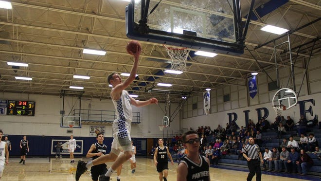 Viking senior Ty Johnson, No. 1, goes up for the shot over the Lincoln County Panthers during a home game at the Heath Center in regular season game play.