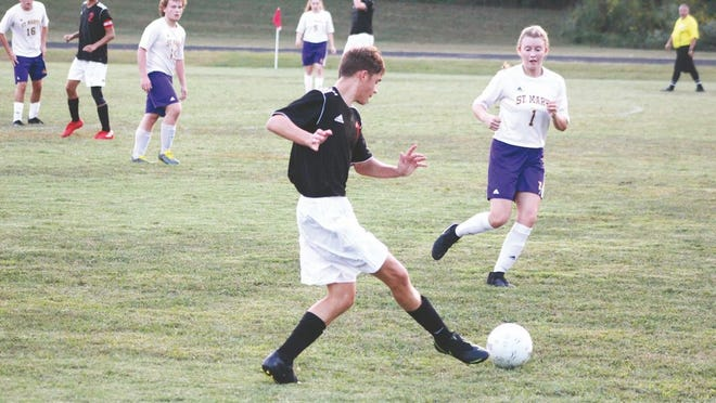 Ravenswood's Caleb Maxson controls the ball for the Red Devils during a home game against the St. Marys Blue Devils in the 2019 regular season.