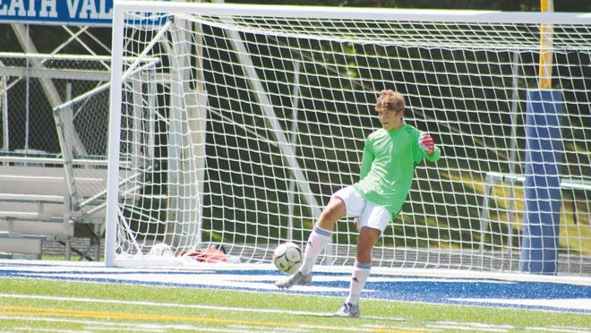 Goal keeper Carter Casto sends the ball back in play during the 2019 Ripley Viking soccer season.