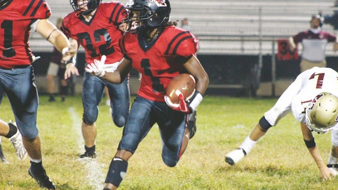 Shawn Banks, No. 1, carries the ball for the Red Devils.