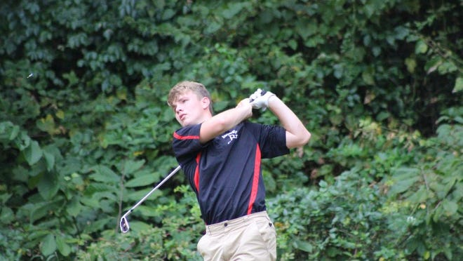 Ravenswood junior Cameron Taylor takes a swing at a recent golf tournament at Greenhills Country Club.