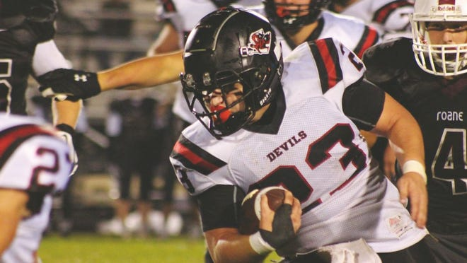 Bryson Litten, No. 23, carries the ball down the field for the Red Devils.