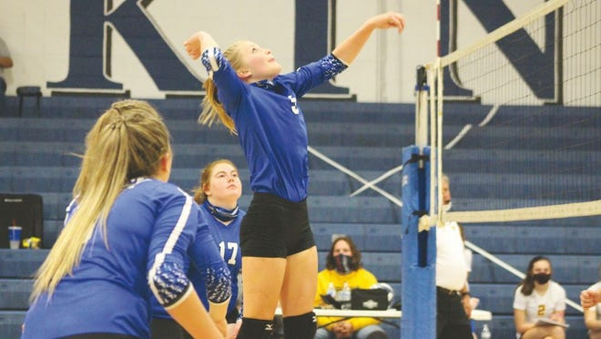 Lady Viking Olivia Banton, No. 5, jumps up to go for the spike.