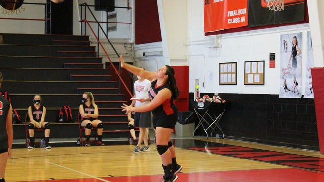 Junior Braylin Tabor serves at a recent home game in Ravenswood.