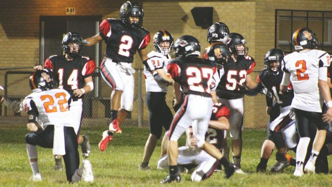 Red Devil junior Xavier Rodriguez, No. 2, jumps to block the Bobcat's extra point.
