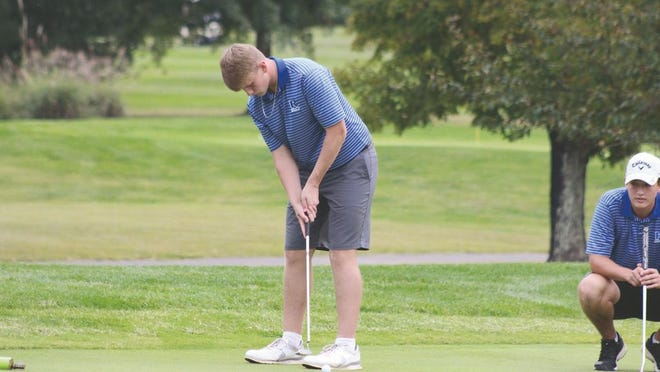 Ripley's Andrew Manley prepares for the putt as his teammate Davis Haynes watches.