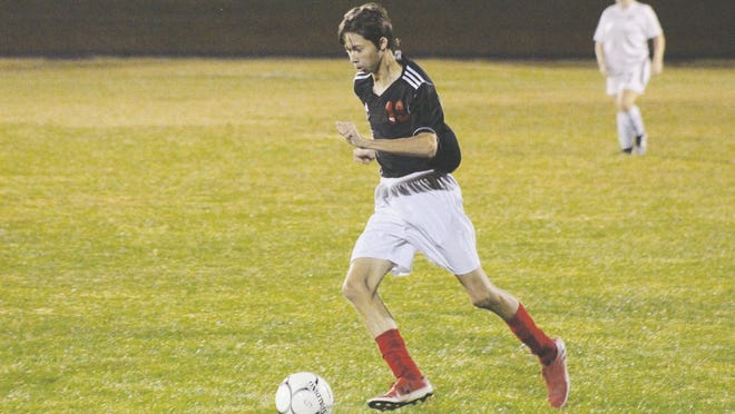 Junior Tyler Brown takes the ball down the field for the Red Devils.