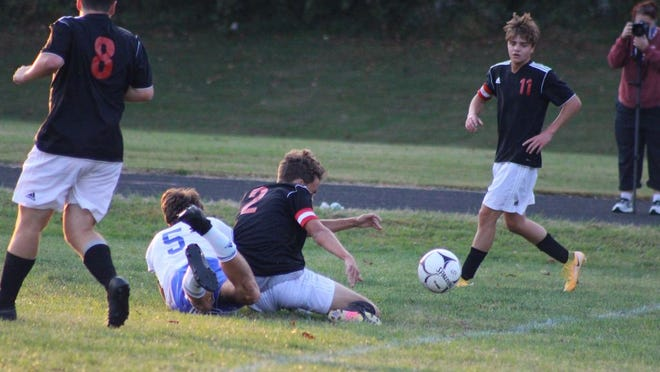 Players collide on the soccer field during the Ripley versus Ravenswood boys' soccer game on Tuesday, Oct. 6.