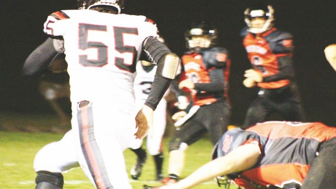 Junior Brandon Bragg, No. 55, eludes a Highlander as he carries the ball into the end zone for the Red Devils duirng Friday night's game in Webster County.