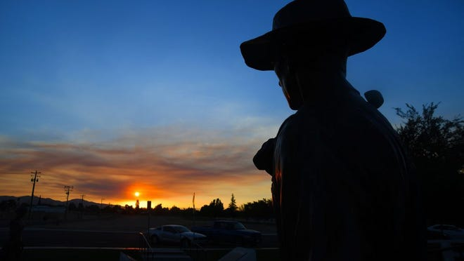 Smoke from Branch fire in the California Valley colored  Tuesday's sunset at the Oilworker Monument