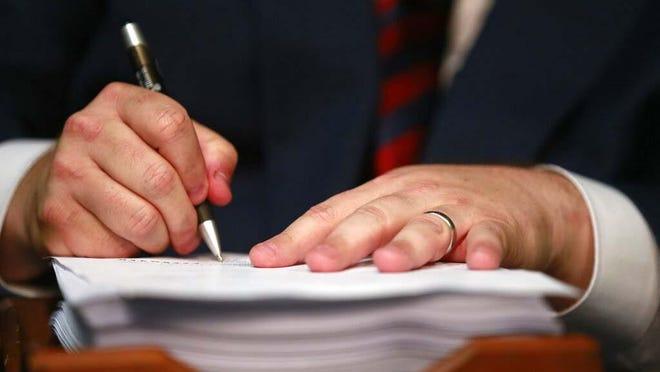 Gov. JB Pritzker signs legislation in this file photo from 2019.