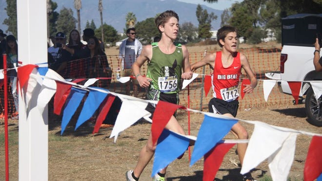 Bryce Hill (1756) finishes .1 second behind Big Bear's Max Sannes (1712) during the CIF-SS Cross Country Finals in Riverside on Nov. 23, 2019. Hill finished fifth overall, qualifying him for last year's State meet.