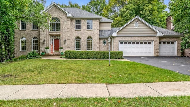 This custom-built home features two brick fireplaces, hardwood floors and nearly 4,000 square feet of living space at 5306 Parliament Place, Rockford.