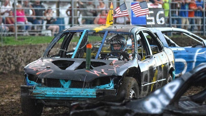 Drivers compete in the Western Illinois Figure 8 Racing Series at the Warren County Fair. This year's fair has been canceled due to coronavirus concerns and statewide restrictions.