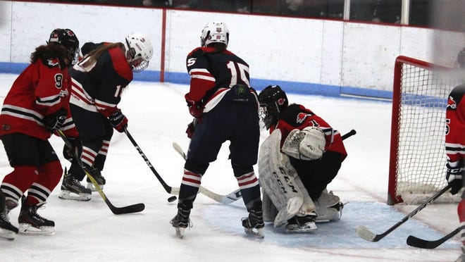 Bismarck's Allisyn Hulst prepares to attempt a shot against Devils Lake's goalie Molly Black with Bismarck teammate Madison Brown (15) and Devils Lake's Hannah Houle (9) on the play during a NDHSAA girls hockey game Saturday, Jan. 11, 2020 in Devils Lake.